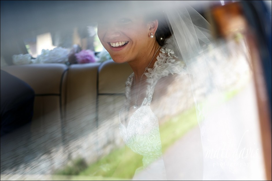 Beautiful smile by bride in wedding car.